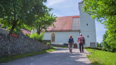An older couple walking to the church Stock Footage
