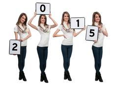 Women Holding New Years Signs - stock photo