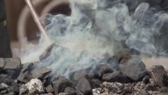 Coal smokes after extinguishing. Slow motion. Stock Footage