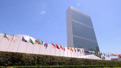 United Nations building headquarters New York City NYC members countries flags Stock Footage