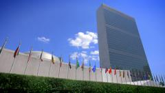NYC United Nations building headquarters New York City members countries flags Stock Footage