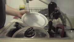 Closeup of hands washing dishes, flat image, 24FPS Stock Footage