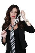 Woman with tangled headphones Stock Photos