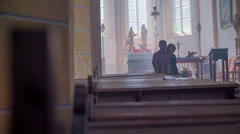 An older couple walking in the church's pew - stock footage