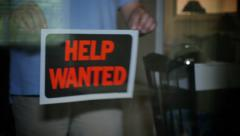 Help Wanted Sign is Placed in Store Window Stock Footage
