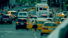 Busy street traffic anonymous cars pedestrians Manhattan New York City NYC day Stock Footage