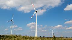 Three wind turbines on a cornfield Stock Photos