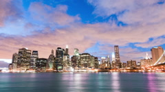 Stock Video Footage of New York City and Brooklyn bridge time lapse at night. Cropped.