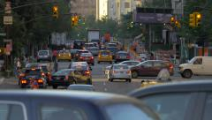 Manhattan street traffic rush hour cars congestion jammed New York City NYC day Stock Footage