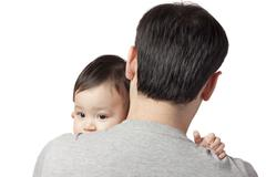 child on the shoulder - stock photo