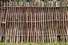 Woven of thin rods in the village Stock Photos
