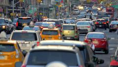 Heavy street traffic rush hour cars congestion commute jam New York City NYC day Stock Footage
