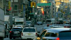 Busy street traffic rush hour cars commute jammed Manhattan New York City NYC Stock Footage