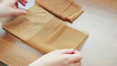 Nylon stockings in hands Stock Footage
