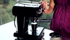 Closeup of expresso machine with woman taking coffee Stock Footage