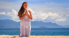 Stock Video Footage of blonde girl in lace demonstrates yoga asana stands on knees