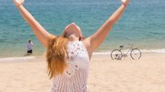 Stock Video Footage of blonde girl demonstrates yoga asana raises hands