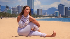 Stock Video Footage of blonde girl in lace shows yoga asana head-to-knee from twist