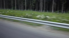 Crash barrier and roadside view from car passenger window Stock Footage