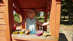 Little cute girl plays with toys in sandbox at playground Stock Footage
