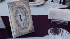 Decorative photo frame as a decorative number of a table at a restaurant Stock Footage