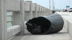 Broken Knocked Over Trashcan On Fishing Pier Stock Footage