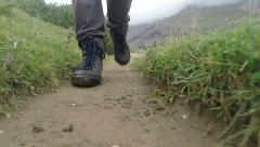 Hiker walking on mountain path with trekking shoes Stock Footage