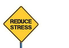 Yellow roadsign with Reduce Stress message - stock photo