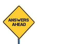 Yellow roadsign with Answers Ahead message - stock photo