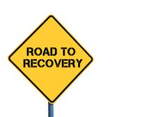 Yellow roadsign with Road To Recovery message Stock Photos