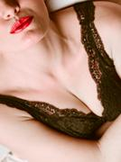 Closeup of woman bust chest and lips. Stock Photos