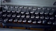 Light Sweeps Across Typewriter Keys Stock Footage
