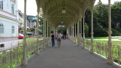 Visitors in the Park Colonnade of Karlovy Vary. Bohemia, Czech Republic. - stock footage