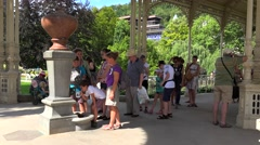 Visitors are drinking the healing water at the Snake spring of Park Colonnade - stock footage