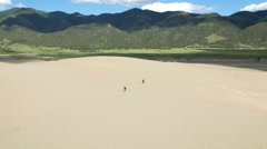Time lapse of hikers on Great Sand Dunes Colorado Stock Footage