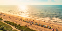Aerial-view timelapse of the coastline in Myrtle Beach just after dawn - stock footage
