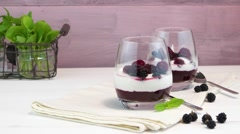 Yogurt desert with raspberries, blackberry and mint. Stock Footage