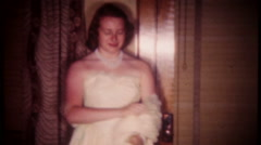 2465 - young woman dressed for the prom dance - vintage film home movie Stock Footage