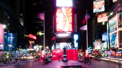 Panning shot of Time lapse in Times Square with people walking around the plaza. Stock Footage