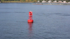 Red buoy on gray water Stock Footage