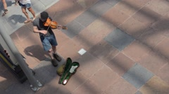 Street Musician Fiddler Violin High Angle Summer Bicycles Pedestrians Stock Footage