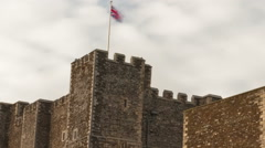 Panning time-lapse of flags blowing over Dover Castle Stock Footage