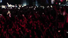 Crowd of people raised hands up at concert Stock Footage