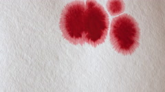 Dripping Ink on Paper. The paper absorbs Ink paint Stock Footage