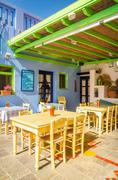 Typical Greek restaurant on fresh air, Greece Stock Photos