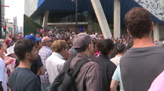 Large crowds of people and performers at Toronto busker festival in summer Stock Footage