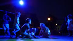 Kids crowd dancing and falling each on other dangerously on disco Stock Footage