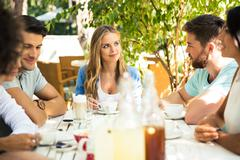 Friends enjoying outdoor dinner party - stock photo