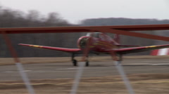 View of red single-engine plane takes off Stock Footage
