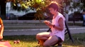 Short hair woman slide and type phone touch screen while a child play toys Footage